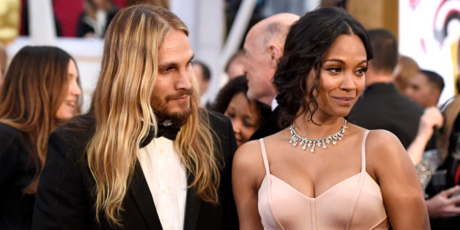 Marco Perego, left, and Zoe Saldana arrive at the Oscars on Sunday, Feb. 22, 2015, at the Dolby Theatre in Los Angeles. (Photo by Chris Pizzello/Invision/AP)